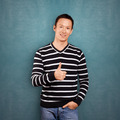 Asian Man In Striped Pullover - PhotoDune Item for Sale