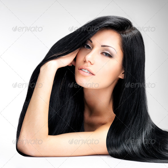 Beautiful  woman with long straight hair - Stock Photo - Images