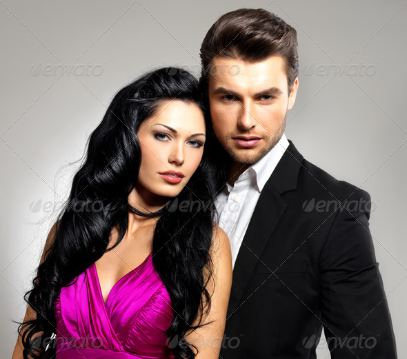 Portrait of young beautiful couple in love - Stock Photo - Images