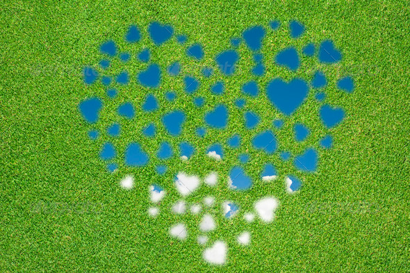 Heart icon with grass and sky - Stock Photo - Images