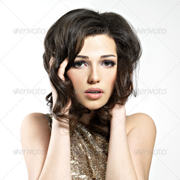 Beautiful brunette woman with style hairstyle - Stock Photo - Images