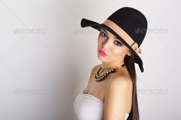 Attractive brunette wearing big black hat - Stock Photo - Images