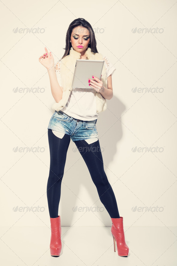Attractive fashionable woman using digital tablet - Stock Photo - Images