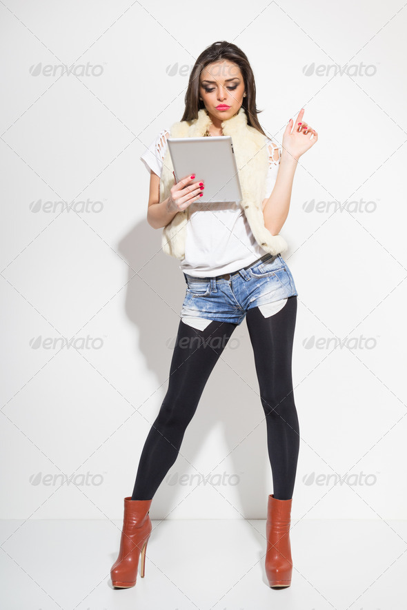 Sexy fashionable young woman using digital tablet - Stock Photo - Images