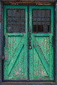 Old wooden warehouse door with a crane hook in front - PhotoDune Item for Sale