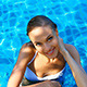 Happy Young Woman Relaxing in Swimming Pool - VideoHive Item for Sale
