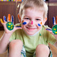 Happy boy with colorful  painted hands - PhotoDune Item for Sale