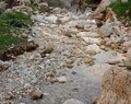 Pebble scree in a small mountain creek - PhotoDune Item for Sale