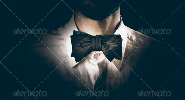 Close-up of a model man wearing bow tie - Stock Photo - Images