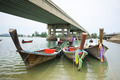 Long tail boat front of phuket bridge - PhotoDune Item for Sale