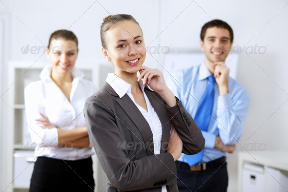 Young business people working together - Stock Photo - Images