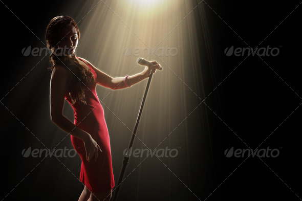 Female singer on the stage - Stock Photo - Images