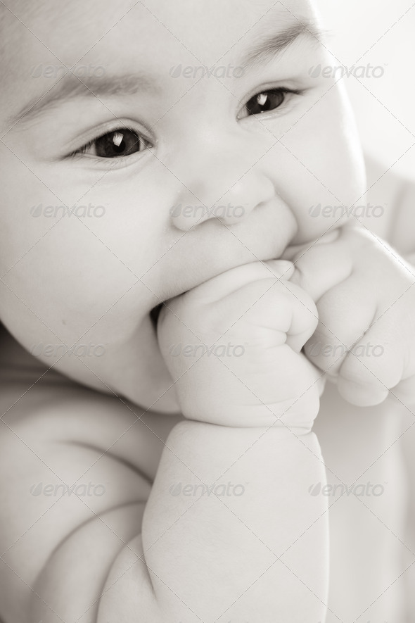baby in pink dress - Stock Photo - Images