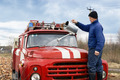 A man washes the fire truck - PhotoDune Item for Sale