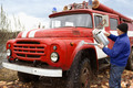 The driver washes the old  fire truck - PhotoDune Item for Sale