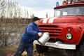 Driver of the water washes the old fire truck - PhotoDune Item for Sale