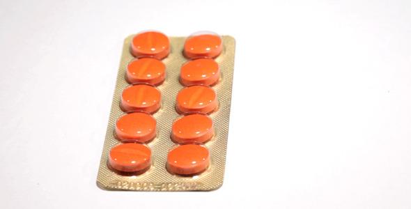 Orange Pills in Dosage Spinning