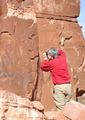 Man Taking Photograph of Petroglyph Panel - PhotoDune Item for Sale