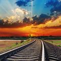 red sunset over railway to horizon