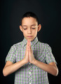praying boy closed eyes over black - PhotoDune Item for Sale