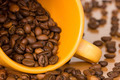 Yellow cup with many coffee beans - PhotoDune Item for Sale