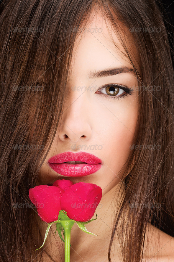woman and red rose - Stock Photo - Images