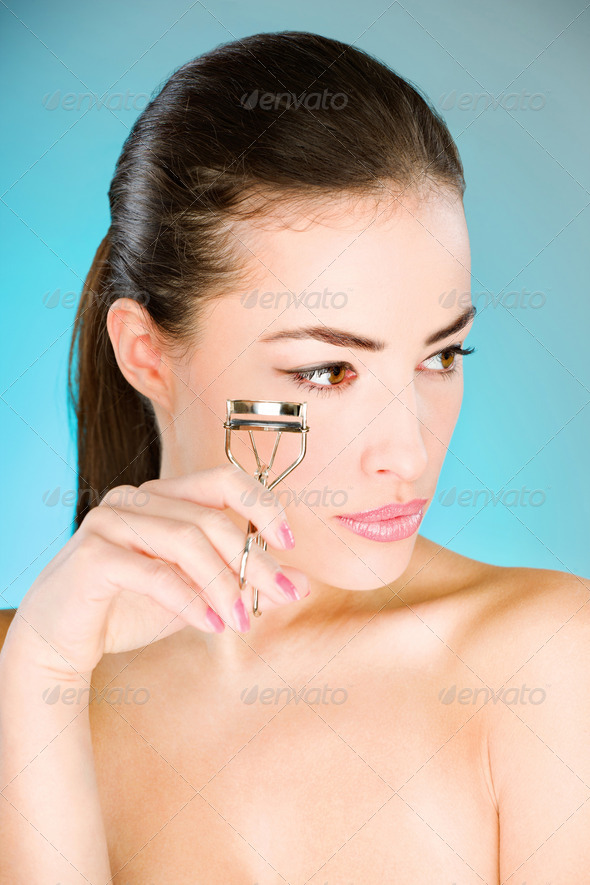 woman holding tool for eyelash - Stock Photo - Images
