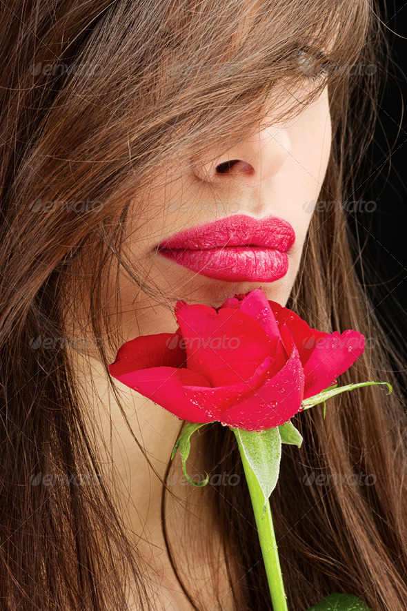 woman and wet red rose near her lips - Stock Photo - Images