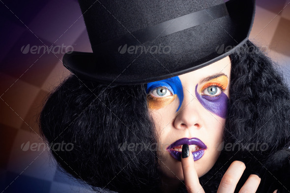 Eccentric mad fashion hatter in colourful makeup - Stock Photo - Images
