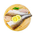 Fillet of codfish on a round board with dill - PhotoDune Item for Sale