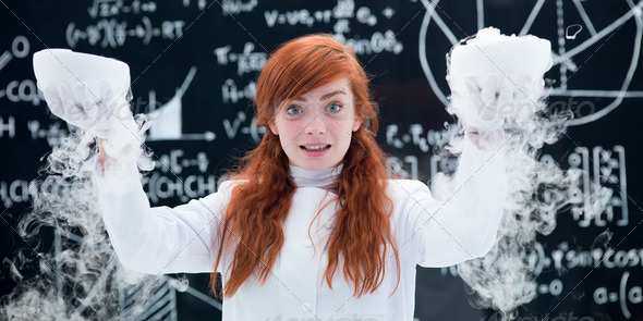 pretty girl conducting a gas lab experiment - Stock Photo - Images