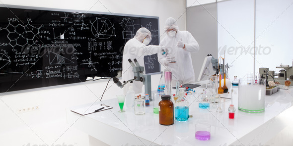 two people working in a chemistry lab - Stock Photo - Images