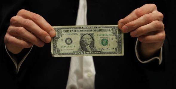 Businessman Rumpling Dollar