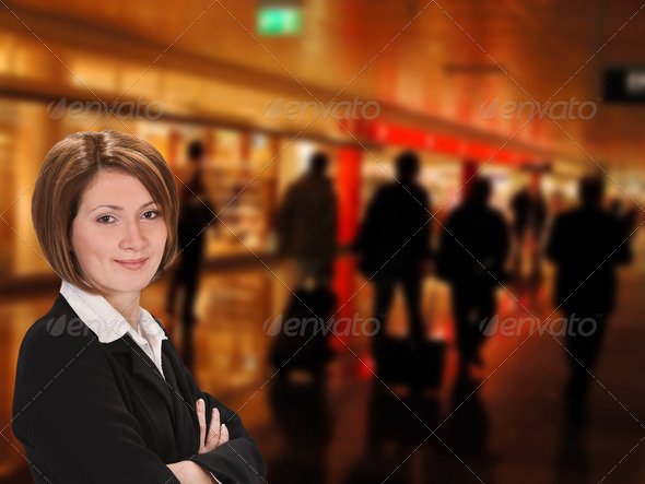 Businesswoman in an Airport  - Stock Photo - Images