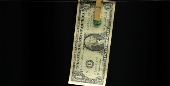 Dollar Hanging From a Rope on Black