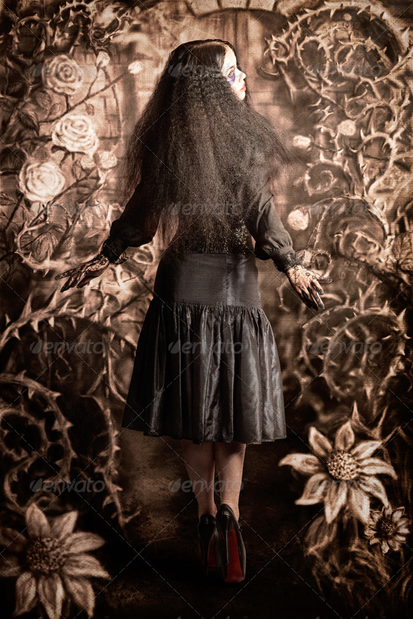 Fairy tale girl walking through secret garden - Stock Photo - Images