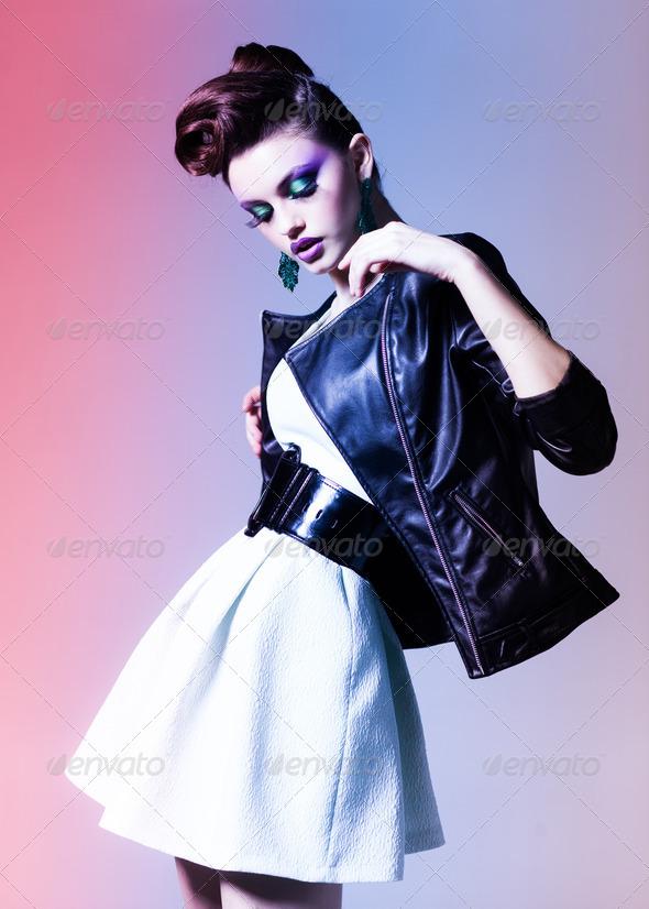 beautiful woman dressed elegant punk posing in the studio - Stock Photo - Images