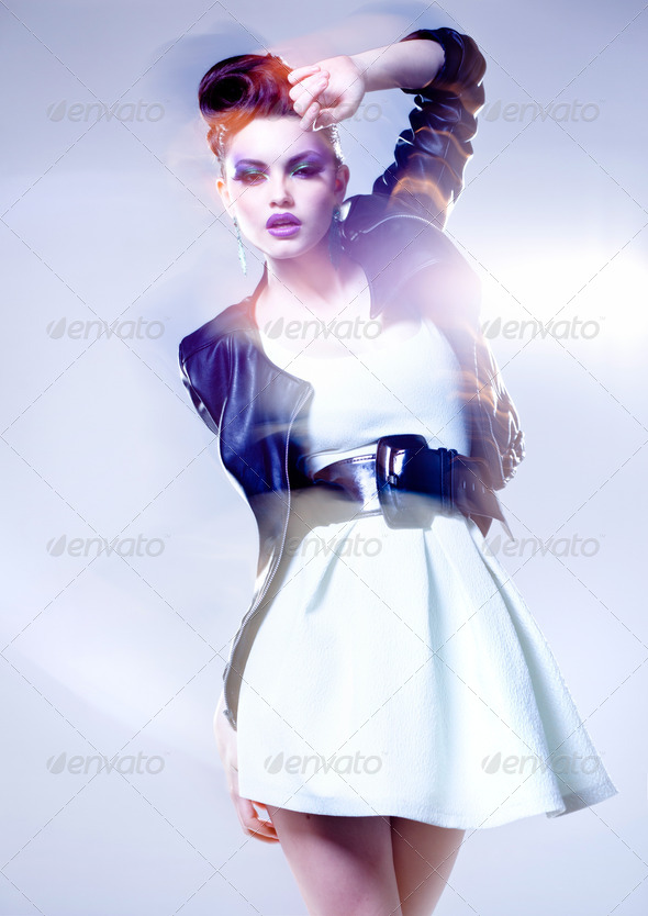 beautiful woman posing in a leather jacket - intentional motion light and colors - Stock Photo - Images