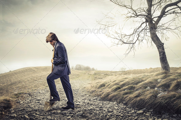 dig a hole - Stock Photo - Images