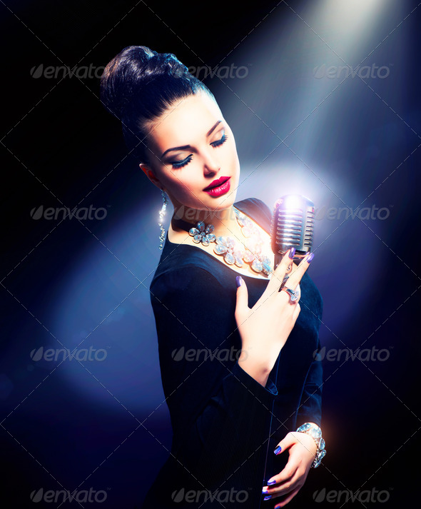 Singing Woman with Retro Microphone - Stock Photo - Images