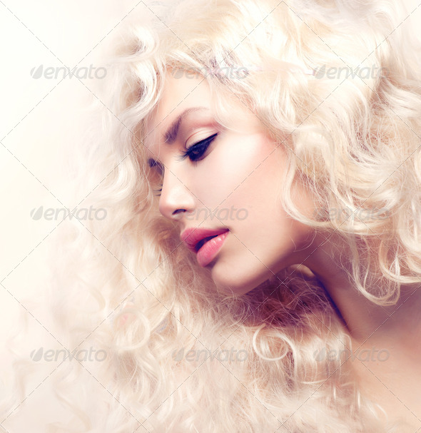 Curly Hair. Fashion Girl With Healthy Long Wavy Hair - Stock Photo - Images