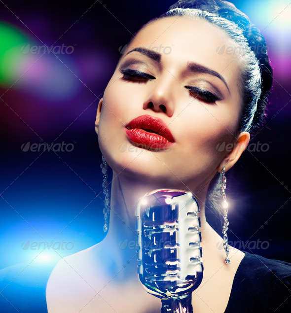 Singer Woman with Retro Microphone. Vintage Style - Stock Photo - Images
