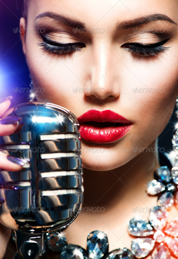 Singing Woman with Retro Microphone. Vintage Style - Stock Photo - Images