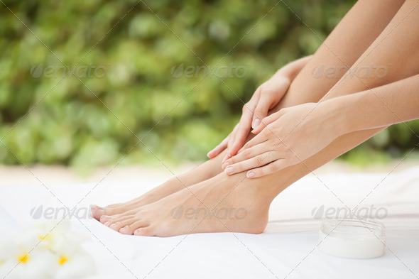 Beautiful Woman Legs And Cream. - Stock Photo - Images