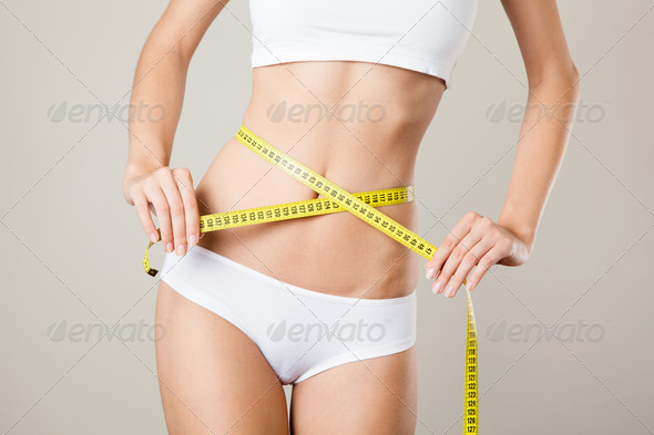 Woman Measuring Her Waistline. Perfect Slim Body. Diet - Stock Photo - Images