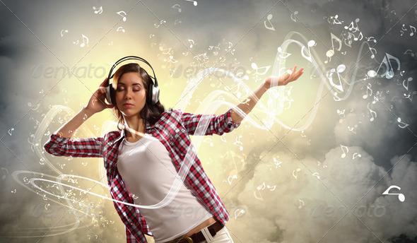 Young girl listens to music - Stock Photo - Images