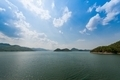 A man made lake as a result of a dam setting up in Thailand - PhotoDune Item for Sale