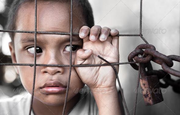 Asian Boy Behind Locked Fence - Stock Photo - Images