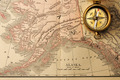 Antique compass over old XIX century map - PhotoDune Item for Sale