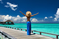 Woman on a beach jetty at Maldives - PhotoDune Item for Sale